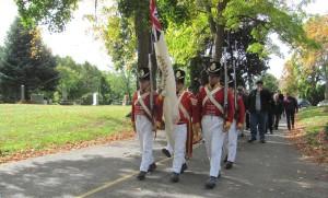 100th Regiment re-enactors lead march to Bradley grave.