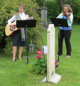 Norma Sedgwick (left, 3X great grand daughter-in-law on guitar) and Grace Taylor (right, 4X great grand daughter on violin) singing and playing 'The Girl I Left Behind Me,' a song from the War of 1812 era.