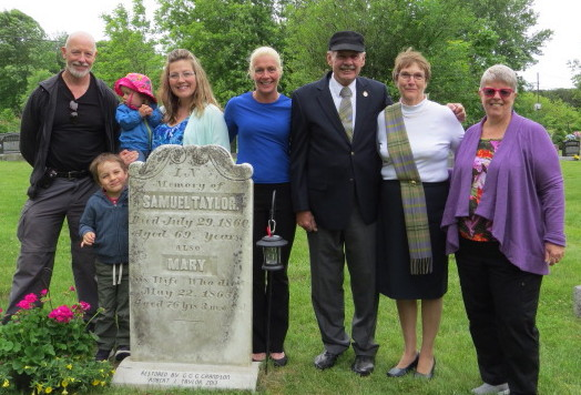 Taylor clan left to right: James Taylor (3X great grandson of Samuel Taylor, 2nd cousin of Robert Taylor); Rianne Lyon (5X great grand daughter of Samuel Taylor); Chace Lyon (front, 5X great grandson of Samuel Taylor) Grace Taylor (4X great grand daughter of Samuel Taylor); Natisha Taylor (4X great grand daughter of Samuel Taylor);Robert Taylor (3X great grandson of Samuel Taylor);Norma Sedgwick (3X great grand daughter-in-law of Samuel Taylor, spouse of Robert Taylor);Christina Taylor (3X great grand daughter of Samuel Taylor; 2nd cousin of Robert Taylor).