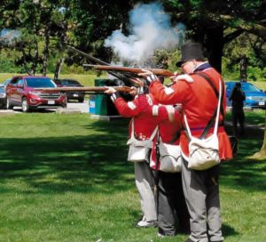 Re-enactors of 2nd Lincoln Militia firing off their muskets in honour of Private Levi Green.
