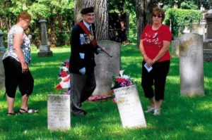 Sgt. At Arms Ted Jablonski of the Royal Canadian Legion Battlefield Branch 622 and 3rd great granddaughters, Lois Smagata and Brenda Denyes , unveil the Graveside War of 1812 Plaque and lay wreaths.